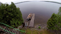 Aerial of Boat Docked on Lake Stock Footage