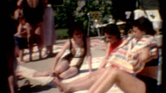 Old film 1960s young girls sunbathing attractive vacation destination cutaway Stock Footage