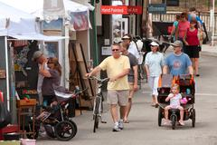 people walk, look and shop at summer arts festival - stock photo