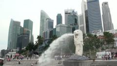 Singapore Merlion Statue and City Skyscrapers Pan Right Stock Footage