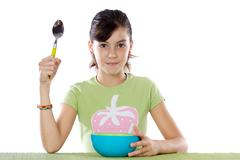 young girl with  blue bowl - stock photo