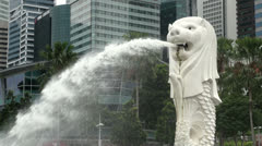 Singapore Merlion Statue and City Skyscrapers Mid Shot Stock Footage