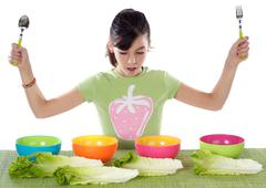 girl with colourful bowls - stock photo