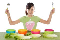Girl with colourful bowls Stock Photos