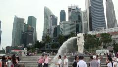 Singapore Merlion Statue and City Skyscrapers Wide Shot Tilt Down Stock Footage