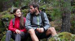 Young couple hiking Stock Footage