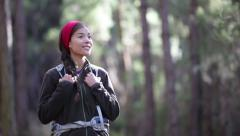 Hiker woman hiking in forest looking around Stock Footage