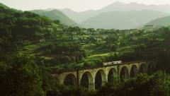 Railway Bridge with Train in Mountains. 4K Stock Footage