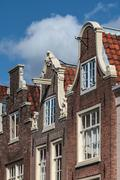 facades of historical amsterdam canal houses - stock photo