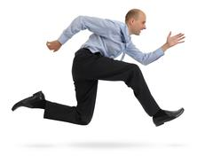 Businessman running isolated on white background Stock Photos