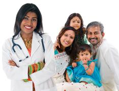indian female medical doctor and patient family. - stock photo