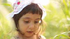 Baby Girl Portrait in Weed Grass Stock Footage