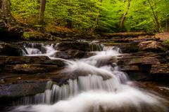 cascades and bright spring greens on glen leigh, in ricketts glen state park, - stock photo