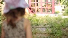 Little Baby Girl Wanders in Garden - stock footage