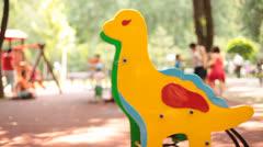 Dinosaur Toy against Playground Background Stock Footage