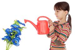girl watering flowers - stock photo