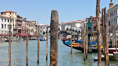Venice - Grand canal at the famous Rialto Bridge on a sunny day Stock Footage