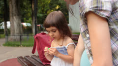 Stock Video Footage of Pregnant Mother and Baby Girl Sit on Bench