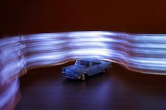 Light painted toy car - stock photo