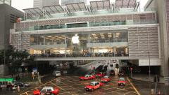 Center of sales of Apple electronics, movement of cars and people. Stock Footage