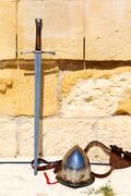 swords, helmet against - stock photo