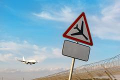 "Road sign ""caution low-flying aircraft"" Stock Photos"