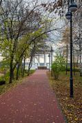 autumn alley with lanterns and rotunda - stock photo