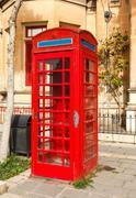 english telephone box on a summer - stock photo