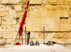 swords, flag, helmet against - stock photo