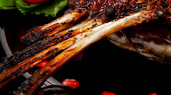 Ribs on black plate Stock Footage