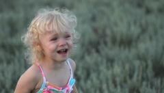 Blonde curly hair baby girl cries and calls mother Stock Footage