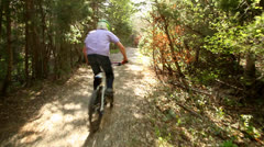 Mountain biking glidecam shot Stock Footage