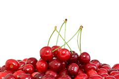 pile of the red cherries with and without stalks - stock photo