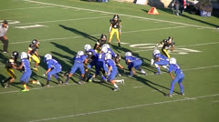 Youth defense end recovers fumble for touchdown Stock Footage