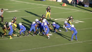 Stock Video Footage of Youth defense end recovers fumble for touchdown
