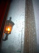 rainy pillar and light fixture - stock photo