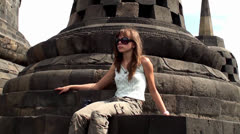 Girl in Borobudur. Mahayana Buddhist Temple, Java, Indonesia. Stock Footage
