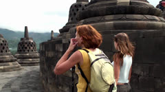 Girl's in Borobudur. Mahayana Buddhist Temple, Java, Indonesia. Stock Footage