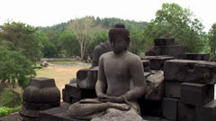 Statue of Buddha sitting in the lotus position. Borobudur Temple. Stock Footage