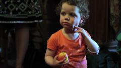 Baby Eating an Apple - Close Up HD Stock Footage