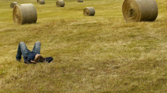 Man relax lying on grass Stock Footage