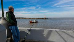 Fisherman waiting by the river - Montevideo Uruguay Timelapse Stock Footage