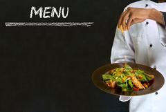 chef with healthy salad food on chalk blackboard menu background - stock photo