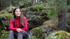 Hiker woman portrait in forest Stock Footage