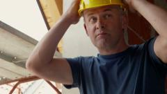 People working in construction site, man with helmet and tools - stock footage