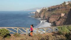 Woman runner running in nature on Tenerife Stock Footage