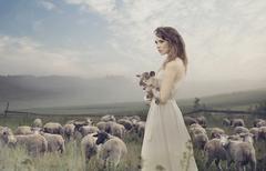 Stock Photo of sensual lady among sheeps