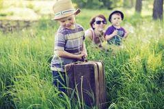 cheerful family playing on tall grass - stock photo