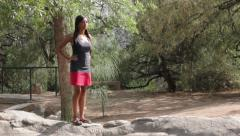 Pretty Asian Woman Stands on Rocks Fidgeting Waiting Stock Footage