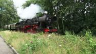 Stock Video Footage of steam train runs towards camera and whistles